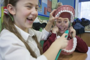 A group of dental students visit a local Primary School to demonstrate oral hygiene to the pupils.