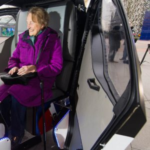 EDITORIAL USE ONLY Brenda Stevenson, 82, from Greenwich sits inside a prototype of the Pathfinder driverless pod, that will be the first autonomous vehicle in the UK to work on public footpaths, which has been unveiled today by the Transport Systems Catapult at a Government launch event in Greenwich, London. PRESS ASSOCIATION Photo. Picture date: Wednesday February 11, 2015. The electric-powered vehicles can seat two people and are designed to work on pavements and pedestrianised areas. They are being built by RDM Group; one of the UK's fastest growing advanced engineering companies, and will be equipped with sensor and navigation technology provided by the University of Oxford's Mobile Robotics Group. Photo credit should: Dominic Lipinski/PA Wire