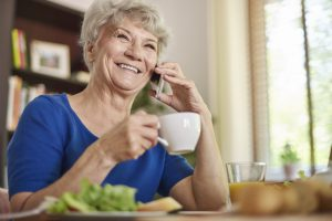 Stock image elderly person with phone